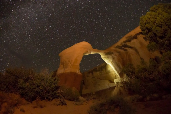 Night view of a stone arch at Devils Garden in Arches National Park, Utah.