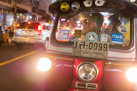 Tuk Tuk, an auto rickshaw a Bangkok, Thailand street at night.