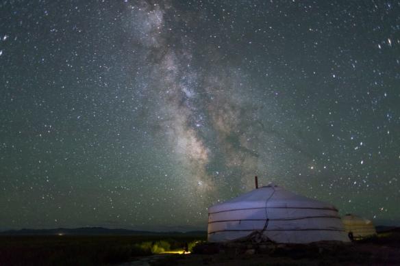 The Milky Way rises over a Mongolian Ger in South Gobi Desert, Mongolia.